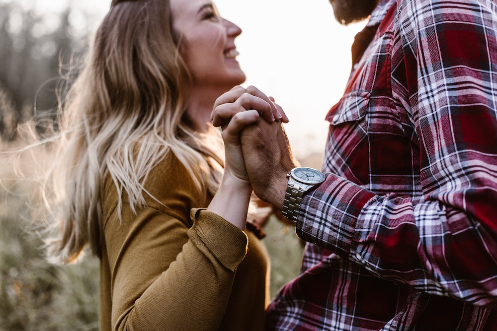 couple holding hands   13 Questions to Ask for a Marriage That Lasts