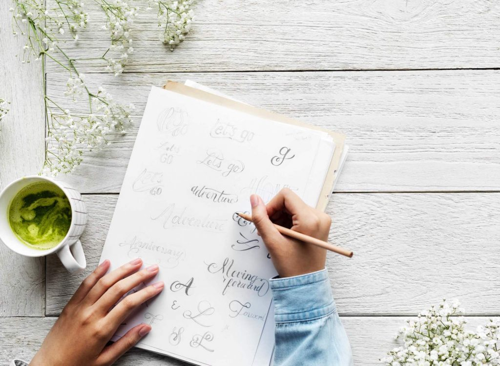 Woman practicing hand lettering