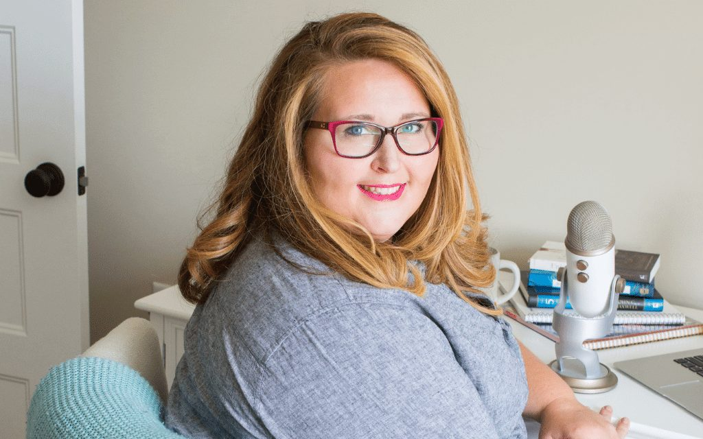 Holly Cain smiling at desk - What kind of financial help do you need in your business?