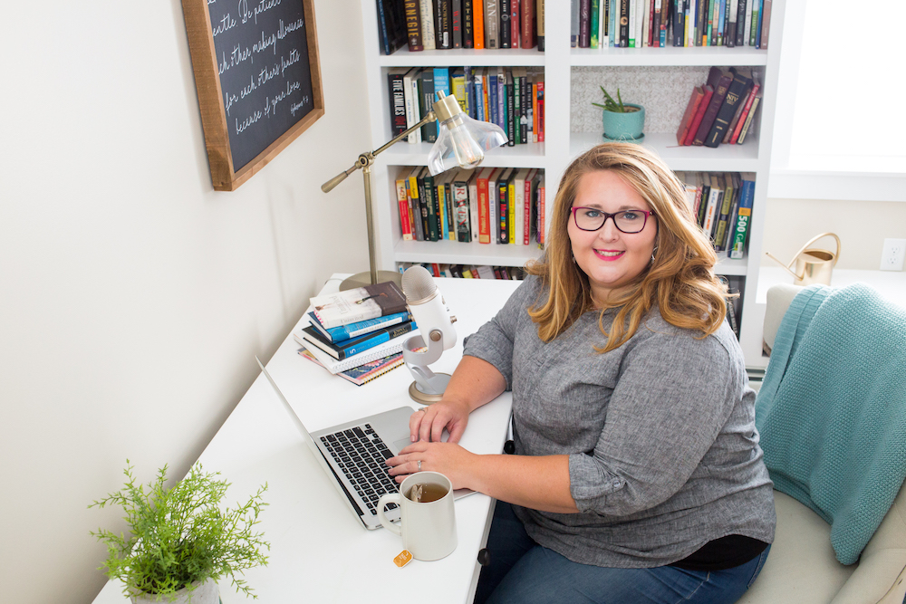 Holly Cain sitting at a desk with a computer