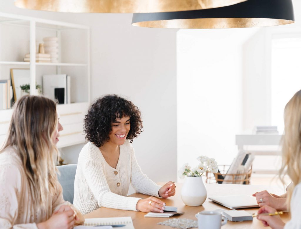 women sitting at a table working - Is something missing in my business?