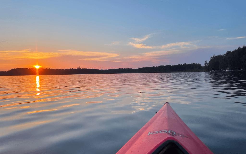 sunset on lake and kayak - take charge of your calendar